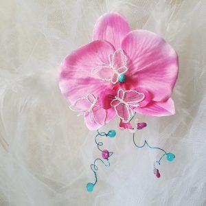 Remonte traîne orchidée, papillons, plumes et perles dans les tons fuschia et turquoise. Réf. 22